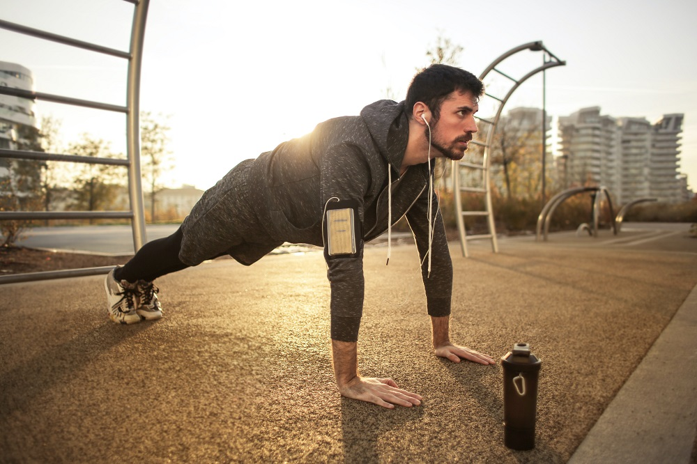 Man excercising at sunrise - Outdoor product photography