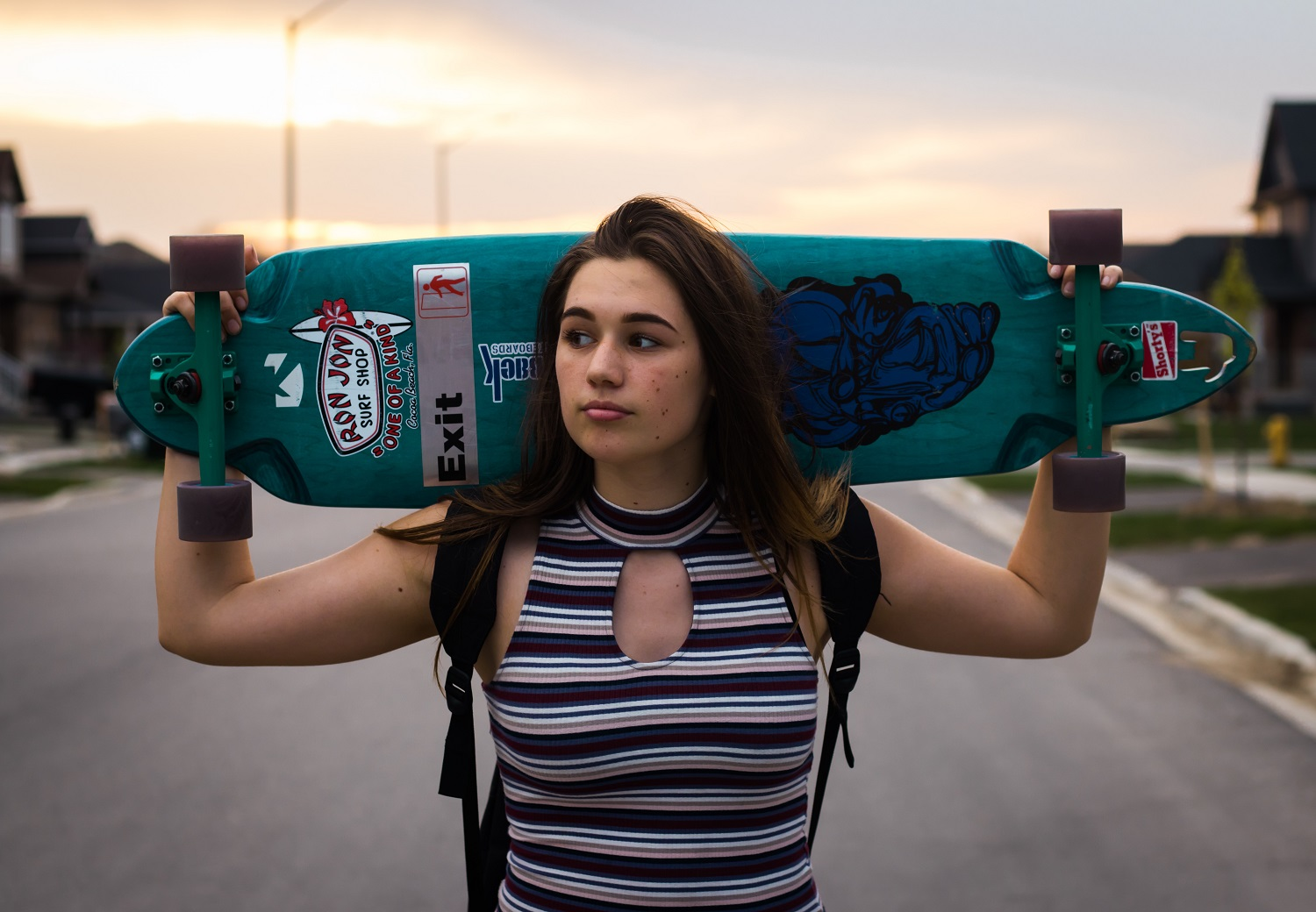 Woman with a skateboard - Outdoor product photography