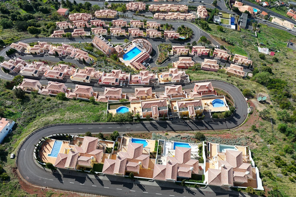 Drone photo of homes - real estate agency tips