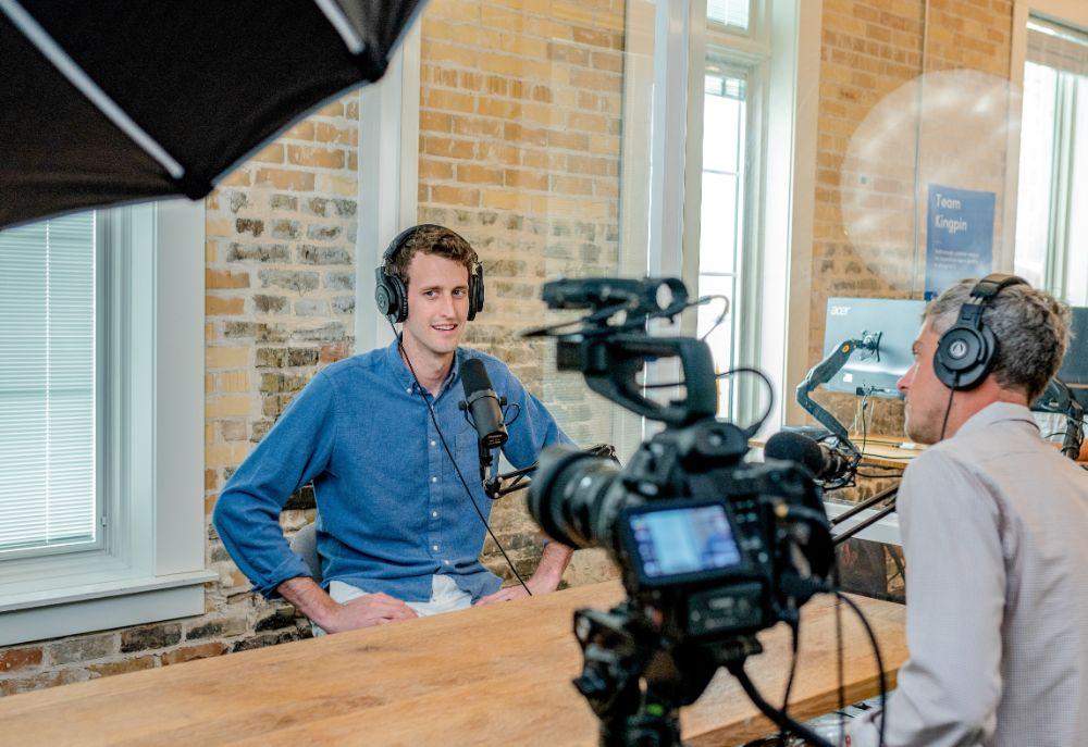 man recording talk