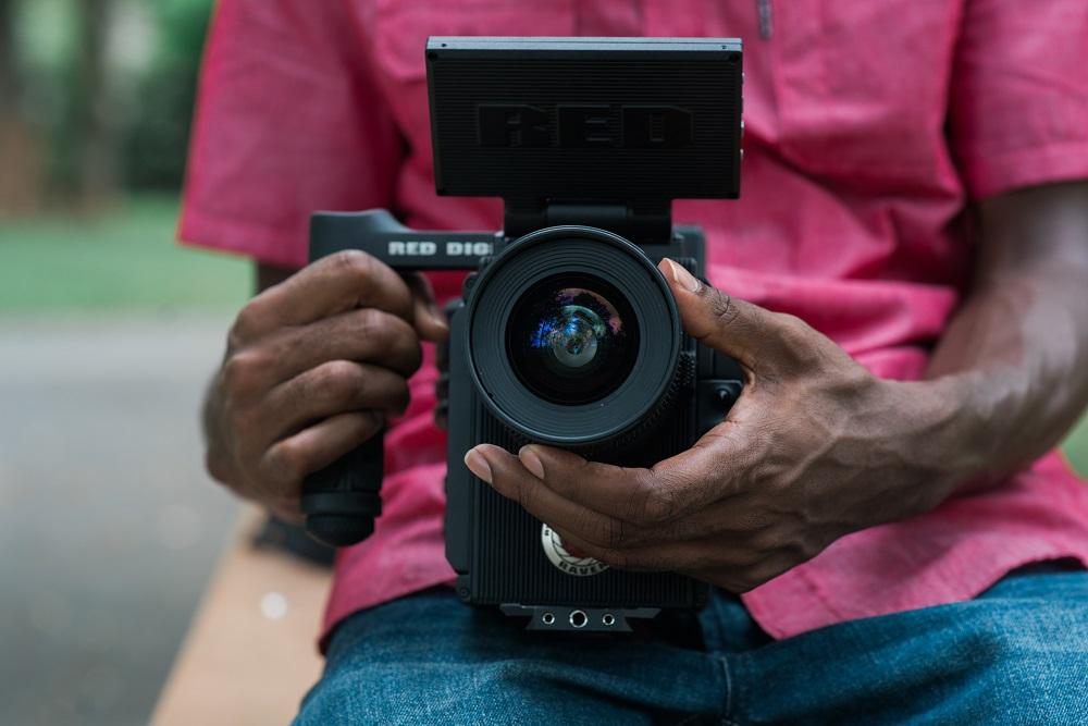 Man holding a video camera